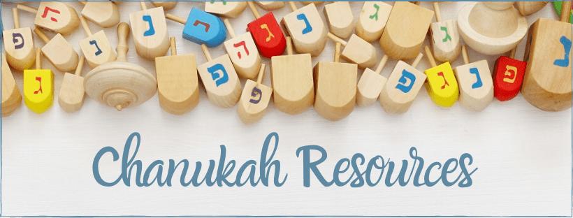 Chanukah resources written below dreidels