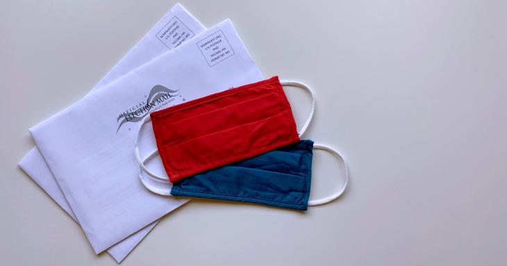 Civic and Civil Engagement image with a blue and red mask and absentee ballot envelopes