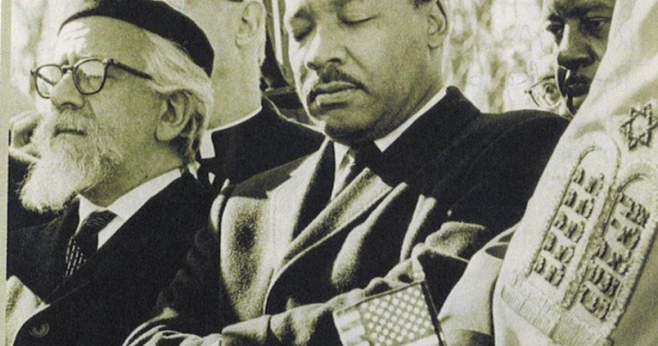 MLK and Rabbi Heschel marching together with a Sefer Torah