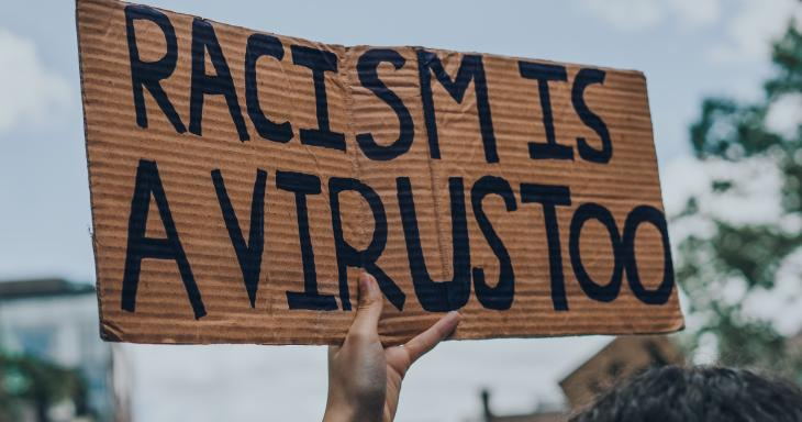 Racism is a Virus, too protest sign