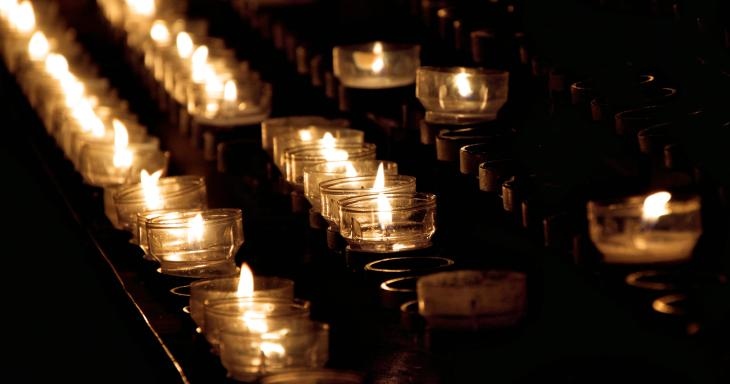 Rows of memorial candles
