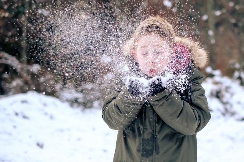 Child outside in snow