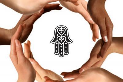 Diverse hands surrounding a Hamsa